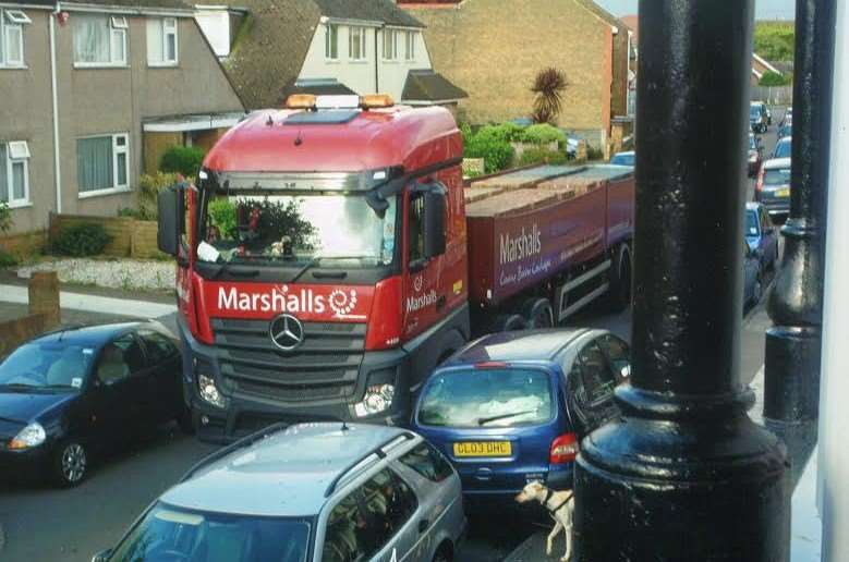 One resident has photographed lorries' attempts in getting past parked cars