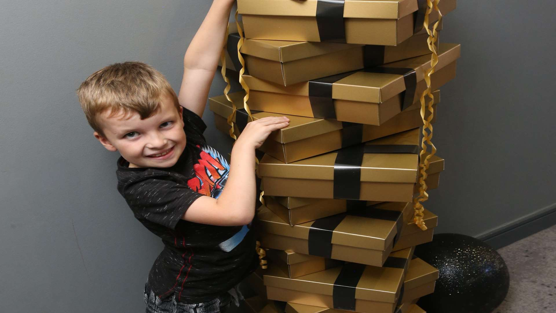 Aidan Louch, seven, checks out the decoration gift boxes at Village Hotel's Yule Fest