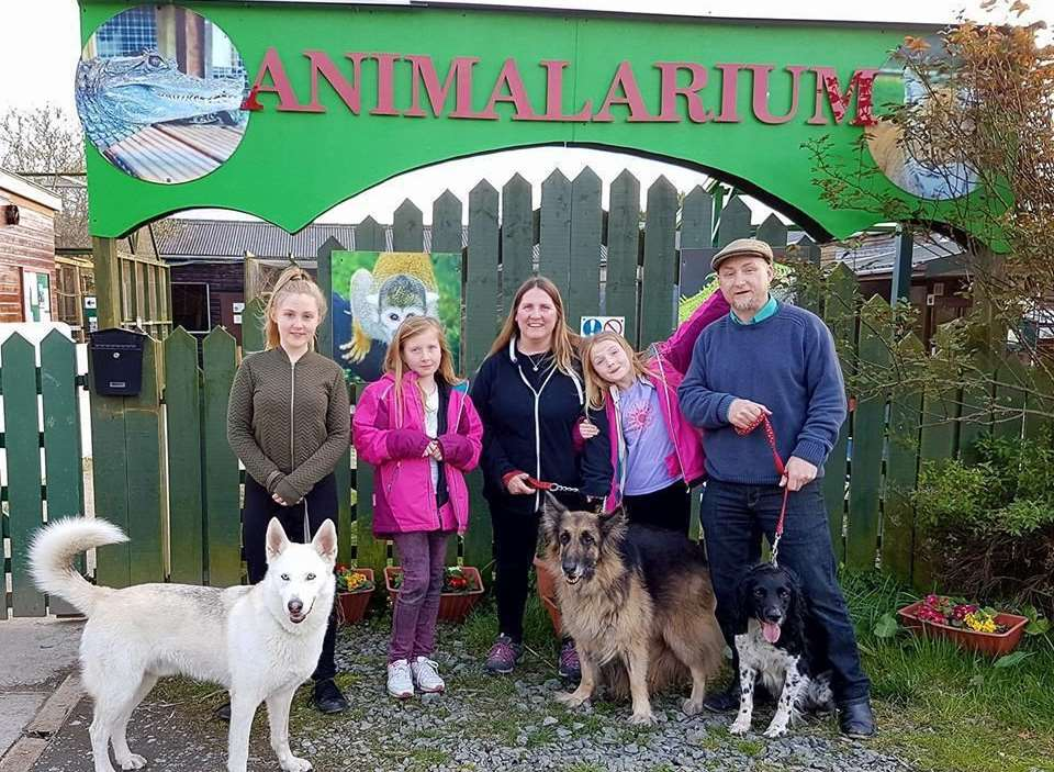 Dean, far right, and family outside their new home