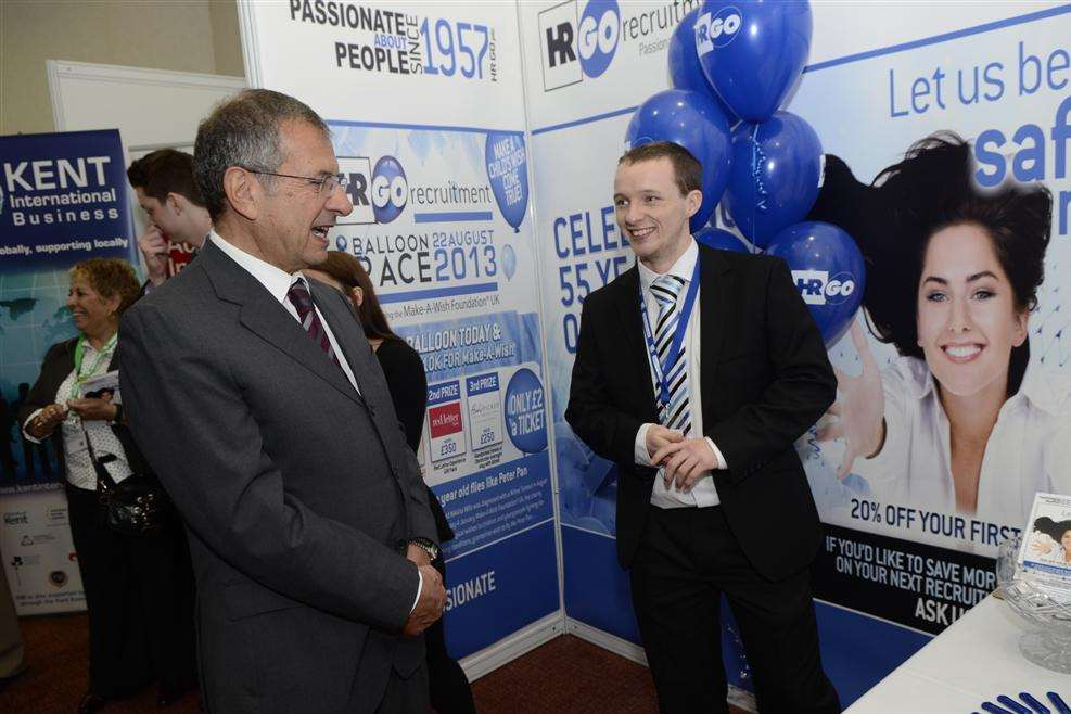 An HRGO Recruitment stand at Kent Invicta Expo at the Ashford International Hotel, visited here by businessman Gerald Ratner