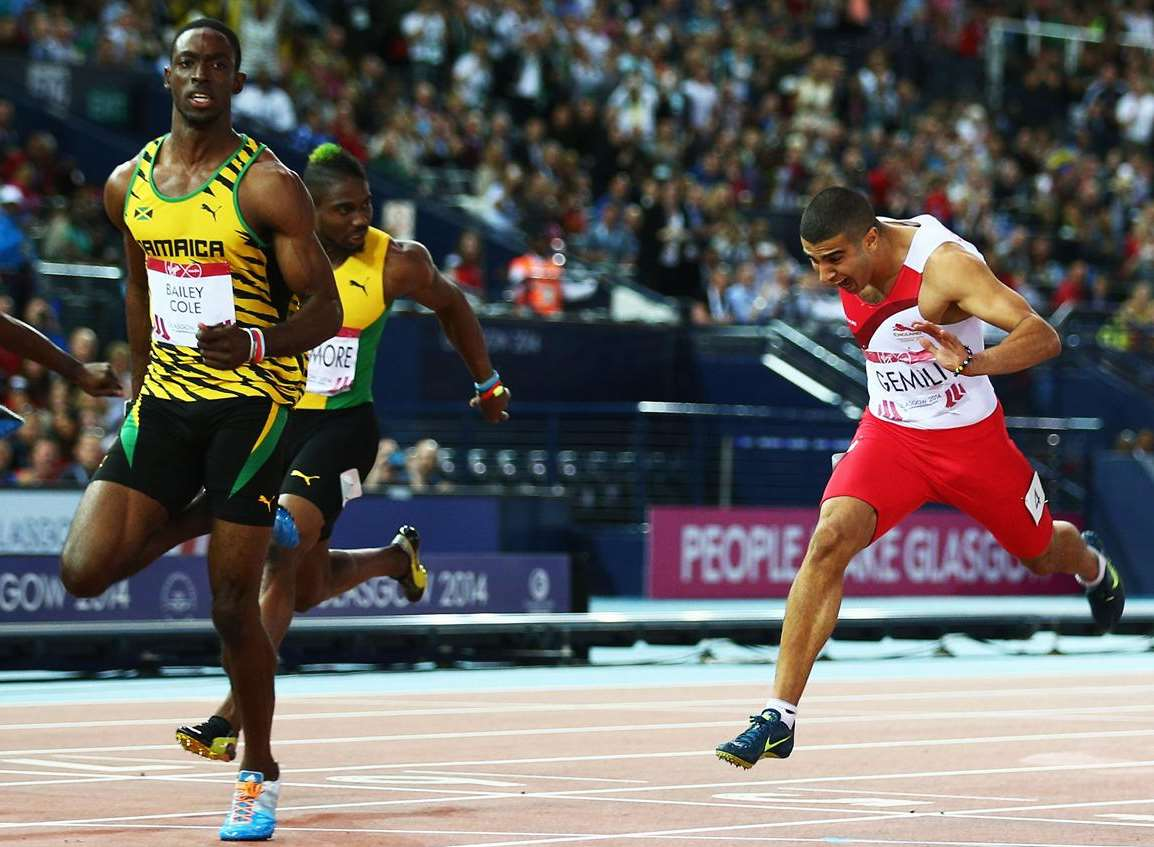 Kemar Bailey-Cole of Jamaica crosses the line to win gold ahead of Adam Gemili, right, in the 100m final at the Glasgow 2014 Commonwealth Games. Picture: Ian Walton/Getty Images