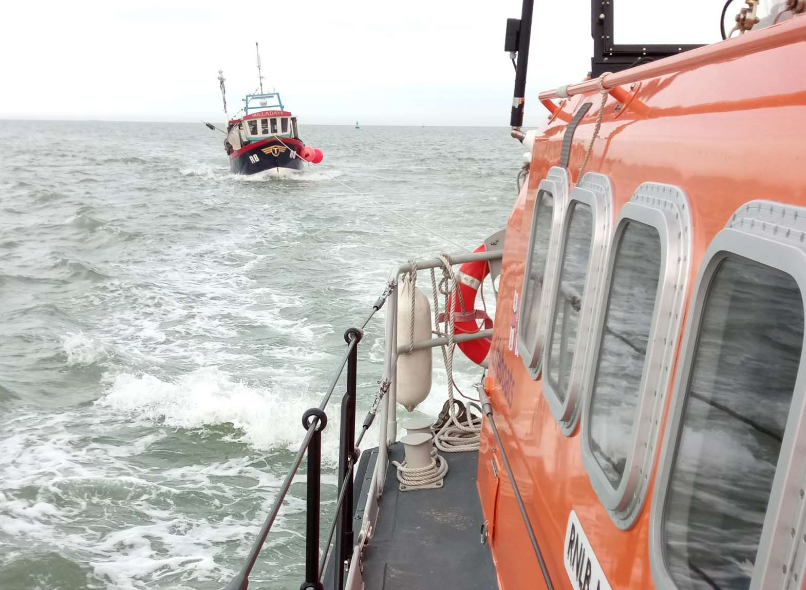 The lifeboat towing the fishing vessel. Picture: RNLI