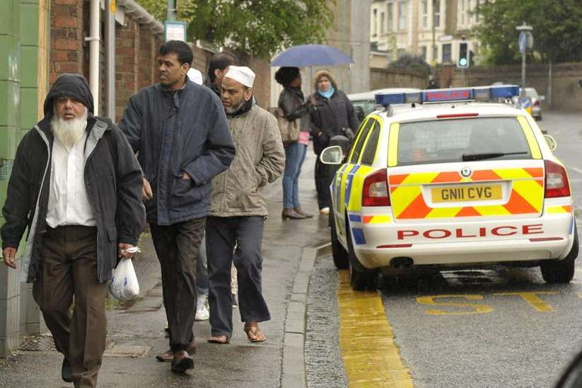 Police cars outside Gillingham Mosque as worshippers arrive