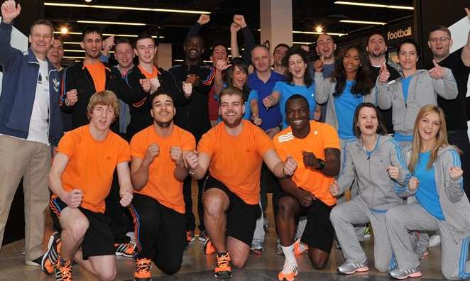 Staff celebrate the opening of the new Adidas store