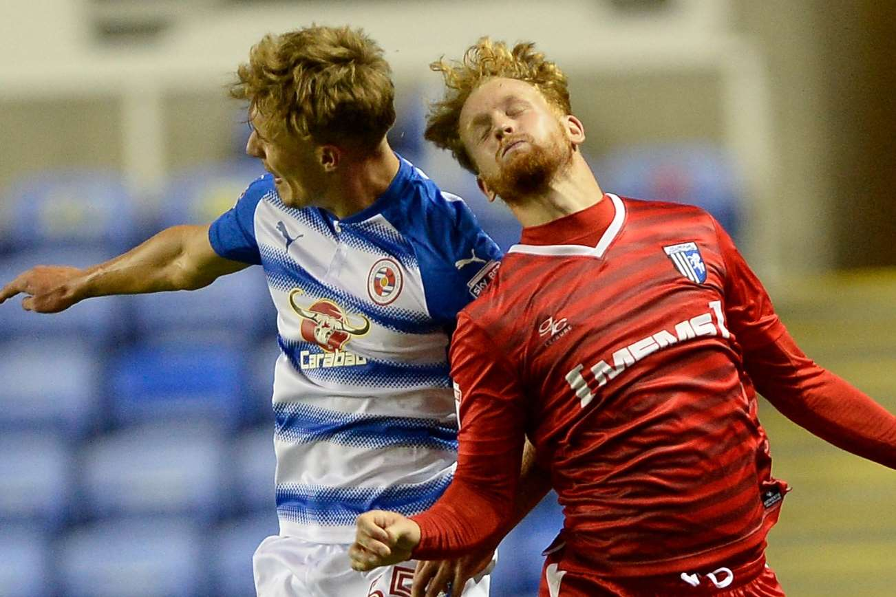 Connor Ogilvie and Reading's Sam Smith leap into action Picture: Ady Kerry