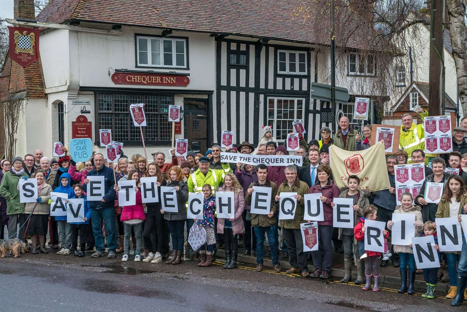 The continuing campaign to save the Chequer Inn. Demonstrators in 2016 when it was saved from housing. Picture courtesy of Matthew Titterton.
