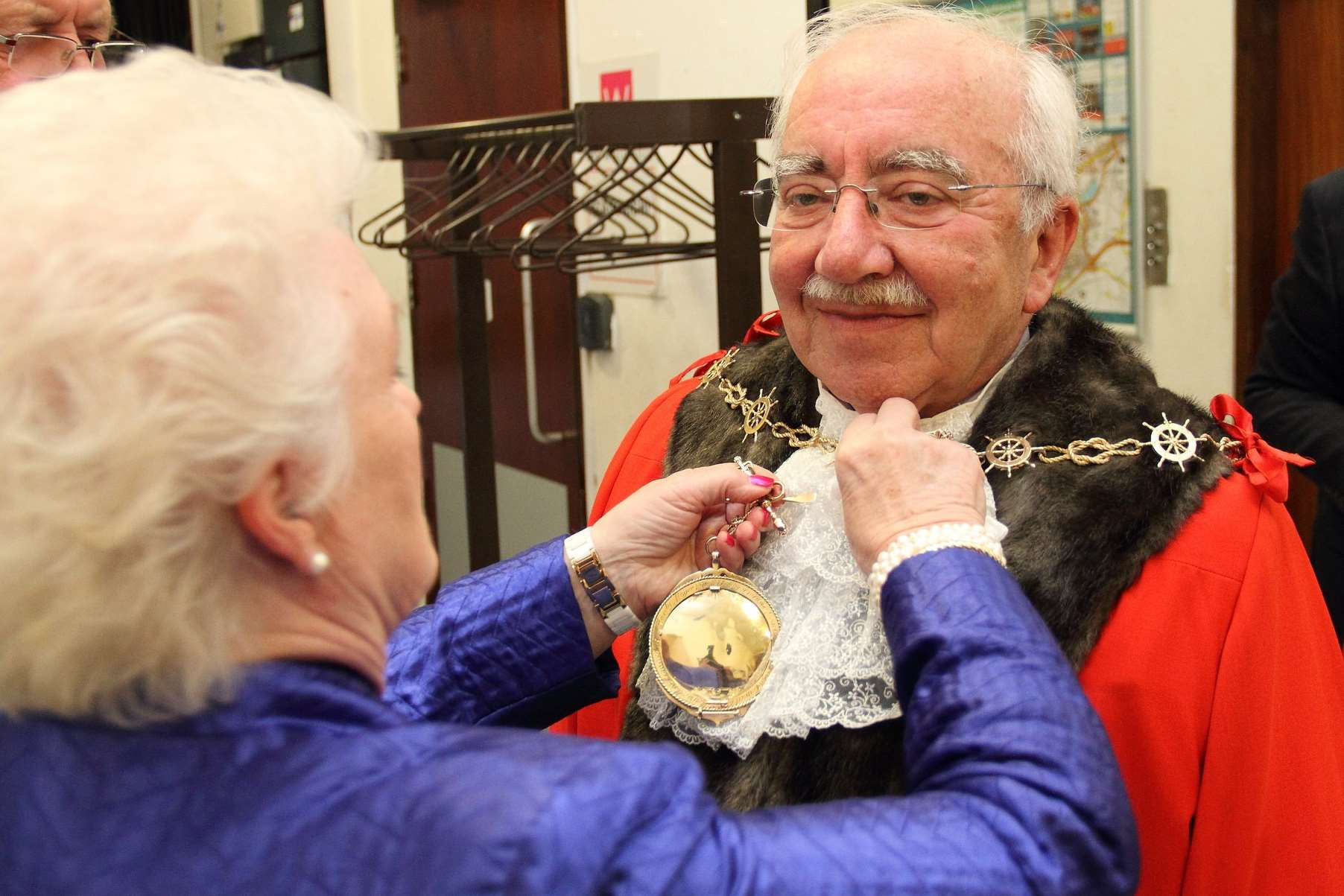 Outgoing mayor Cllr Greta Goatley helps her successor with his mayoral chain. Picture: Gravesham Borough Council