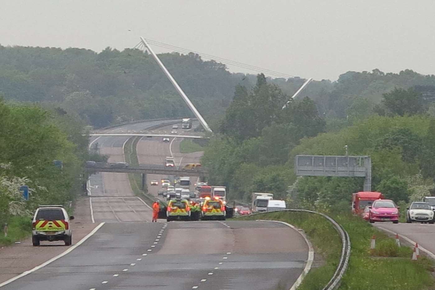 Highways Agency vehicles at the scene on the M20 near Ashford. Picture: Andy Clark