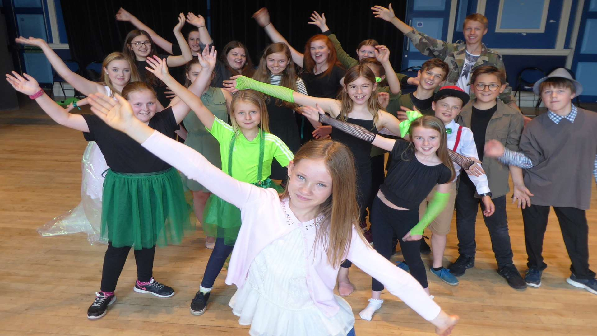 Contest winner Molly Simmonds leads the warm up for the Hazlitt Youth Theatre cast of Wicked.