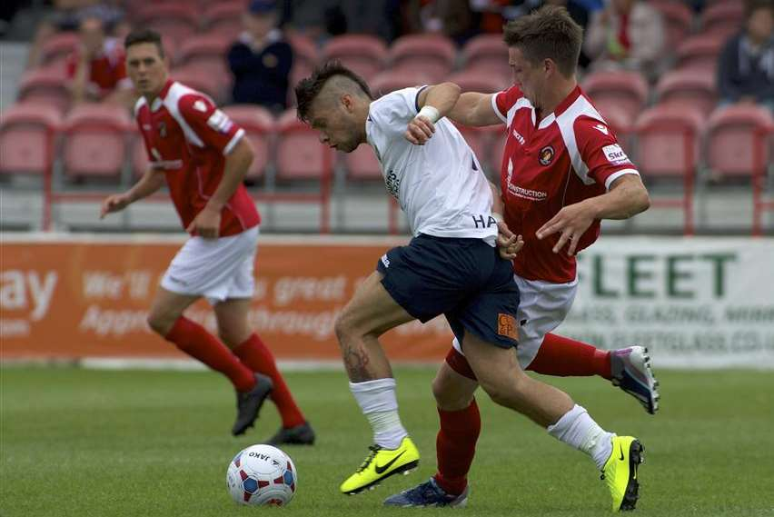 New Dover signing Christian Nanetti (white shirt) takes on the Ebbsfleet defence while playing for Havant & Waterlooville last season
