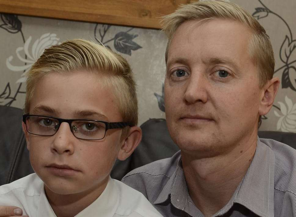 Mugging victim Bradley Rickard and his father Jamie.
