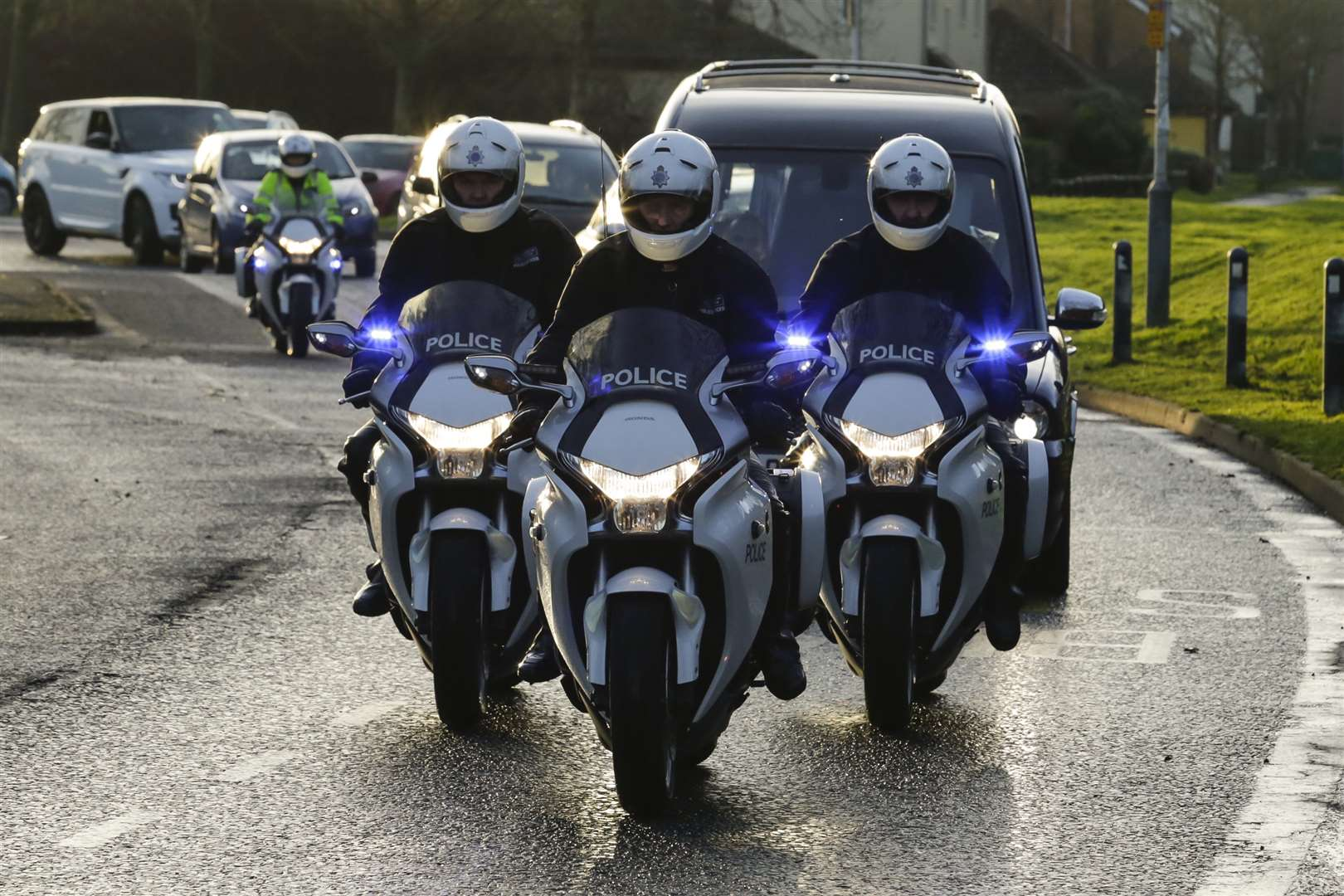 A trio of police motorcyclists give former police bike instructor Michael Copleston an escort at his funeral in Hawkinge