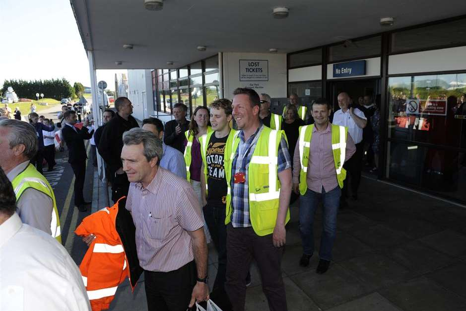 Workers leave the terminal building for the last time. Picture: Tony Flashman