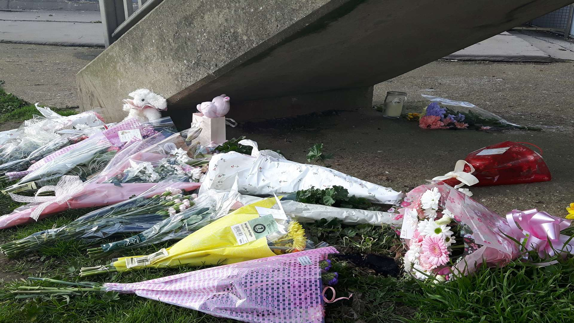 Flowers, candles and teddy bears were left where the body of the baby girl was discovered