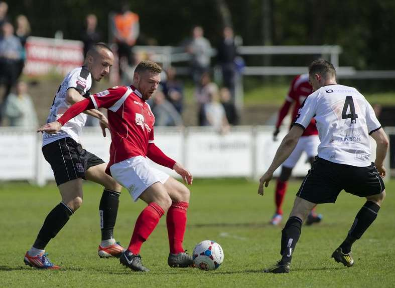 Billy Bricknell takes on two Bromley players Picture: Andy Payton