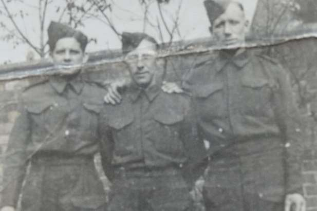 During his time in the Armed Forces, Frank Foster is pictured left with comrades. Picture: SWNS.com