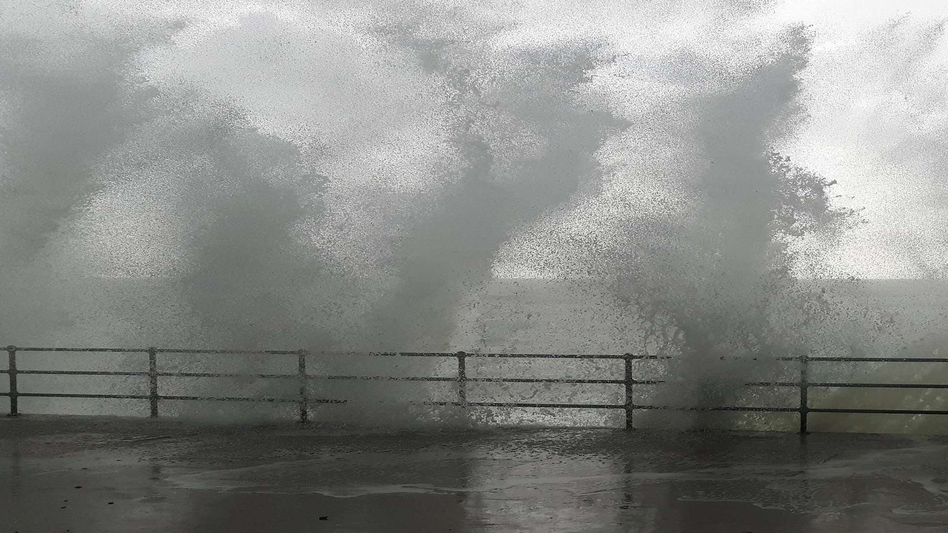 Waves batter the sea wall at Folkestone