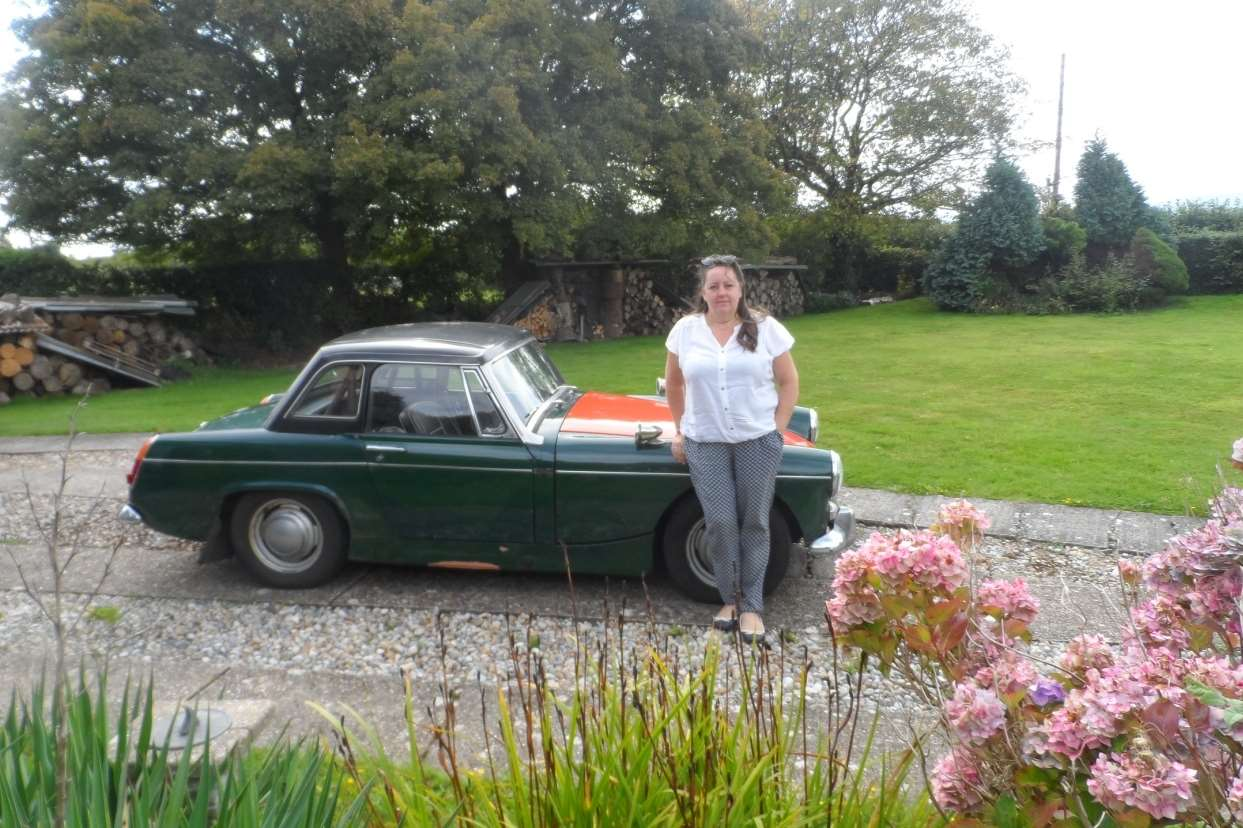 Zoe Snell with the car 40 years later