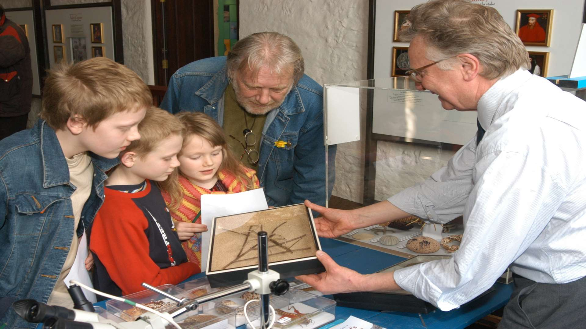 Julian Spurrier showing a stick insect to visitors at Canterbury Heritage Museum