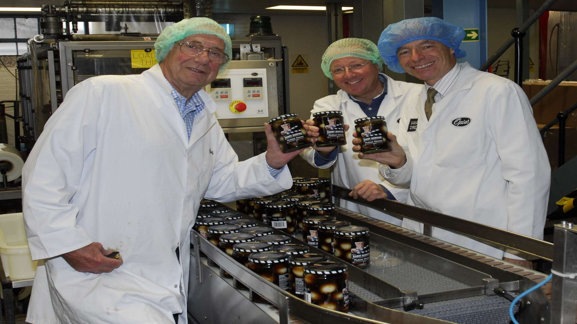 From left, Barry Norman, John Wringe and William Opie with the jars of pickled onions