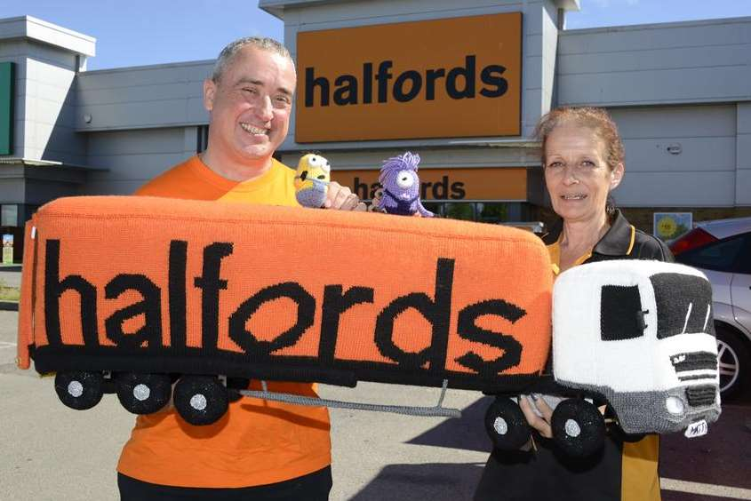 Karen Buckle and colleague Mark Barron with the Halfords truck she knitted
