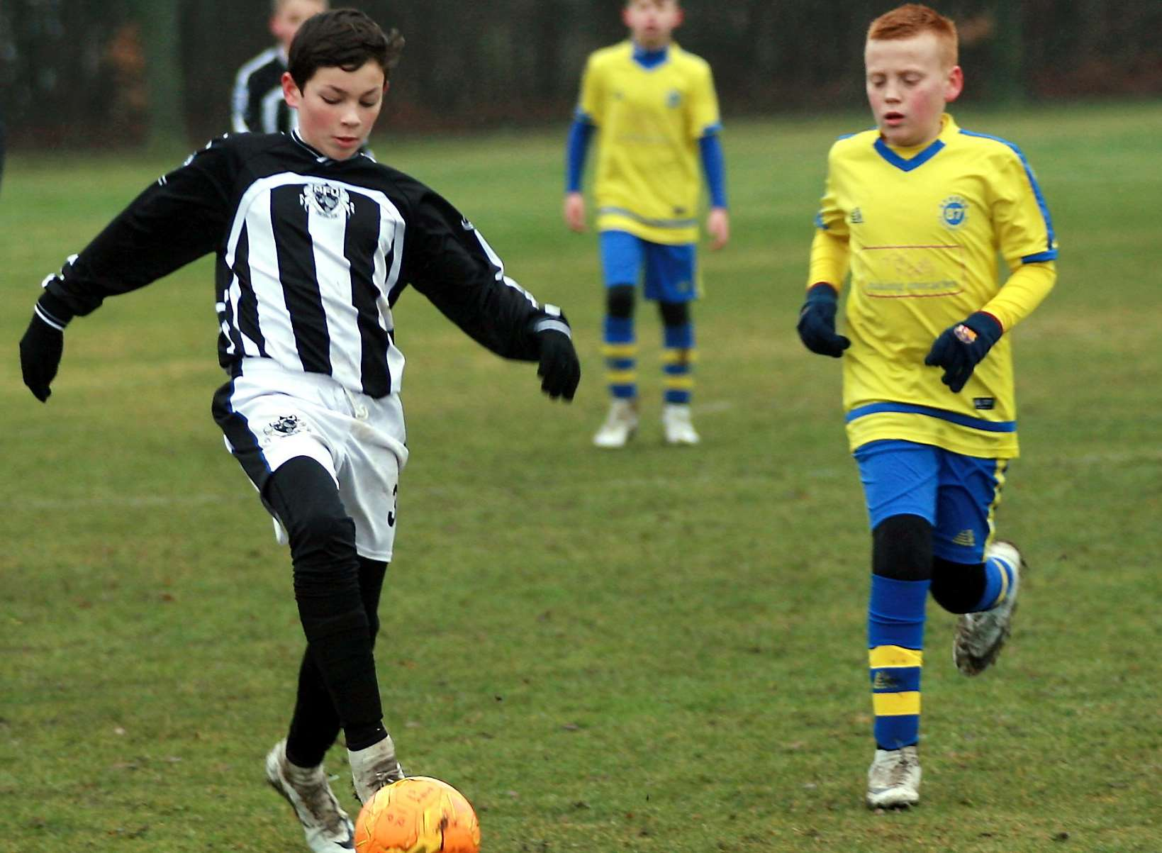 Milton & Fulston United under-12s in possession against Strood 87 Picture: Phil Lee