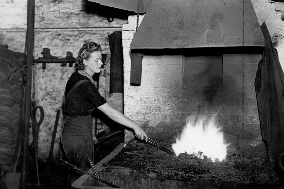A woman blacksmith working at the Railway Works