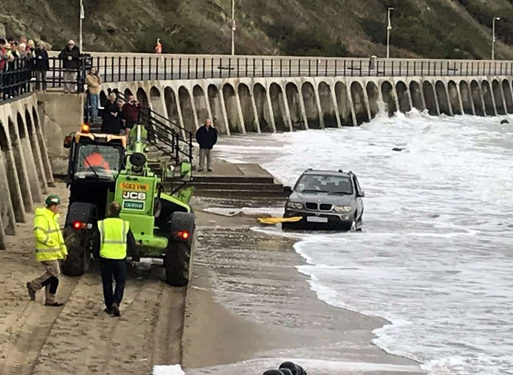The BMW had to be pulled to safety by a JCB. Pic: Folkestone Coastguard