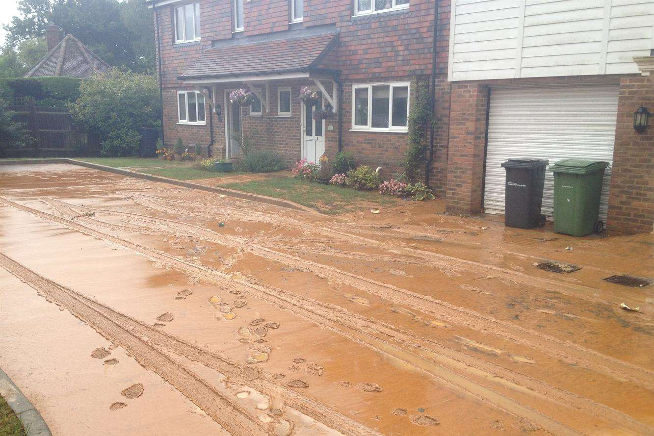 Paygate off Sutton Road was flooded after clay from Imperial Park development was washed down the hill during heavy rain on Sunday