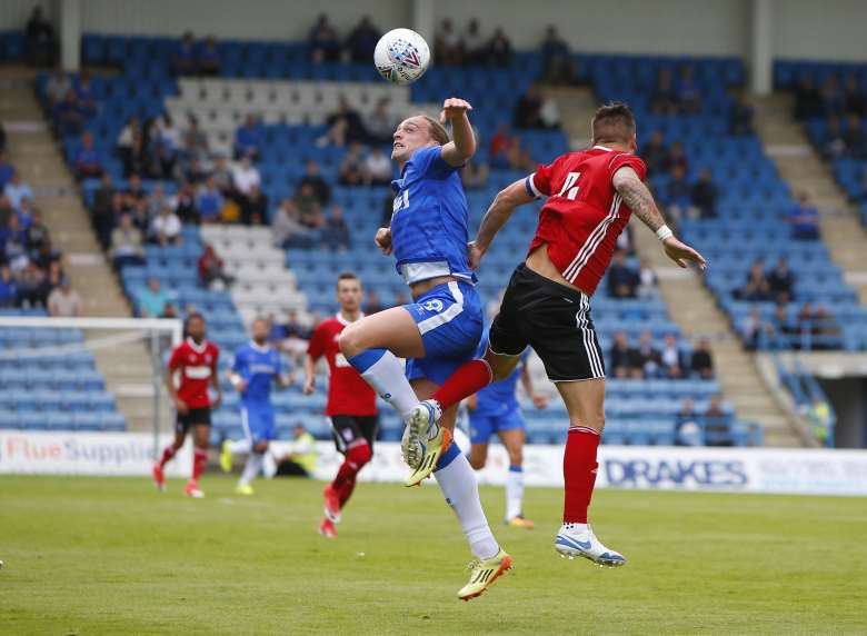 Tom Eaves goes for the ball at Priestfield Picture: Andy Jones