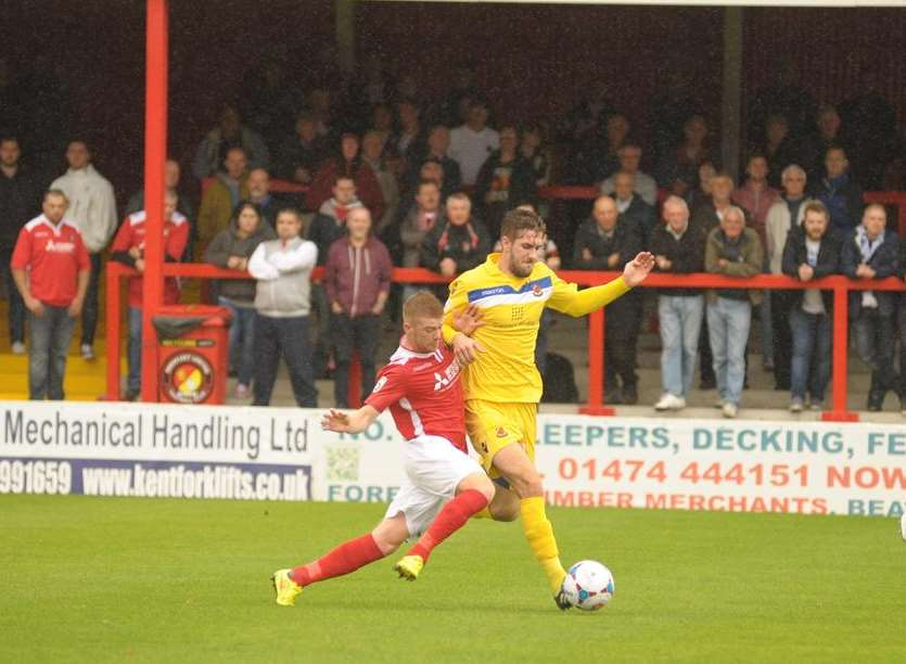 Alex Osborn makes a challenge in front of The Liam Daish Stand Picture: Steve Crispe