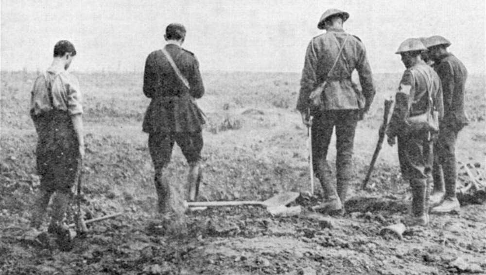 Army chaplain conducting a burial service in the field