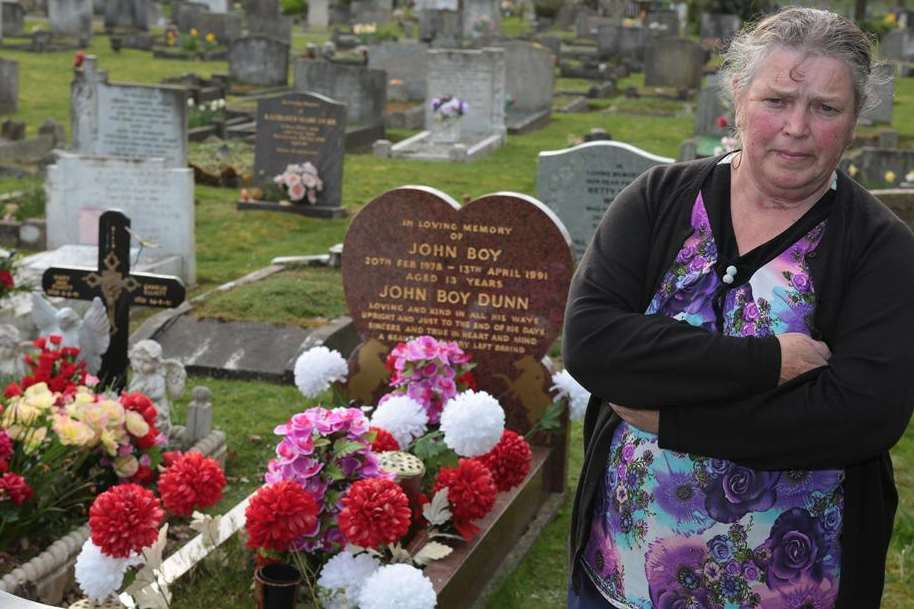 Betty Dunn at her son's damaged grave stone