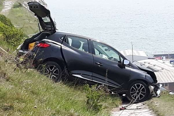 A crashed car was left near the edge of the White Cliffs in April.