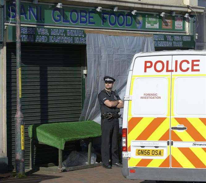 Police outside the Luton shop where Harjit Chaggar's body was found