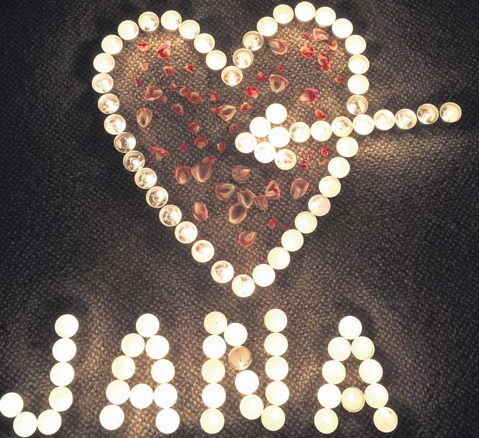 Tealights spelt out Jana's name under a heart filled with petals