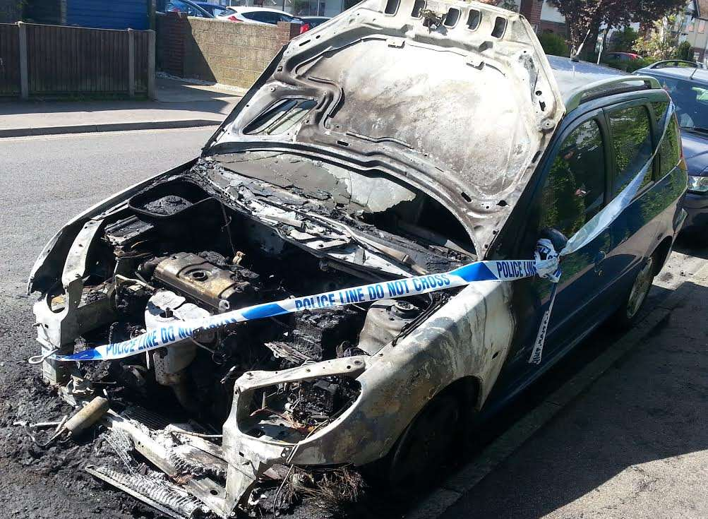 Write off: This car was found alight opposite Malcolm Waite's garage in Park Avenue.