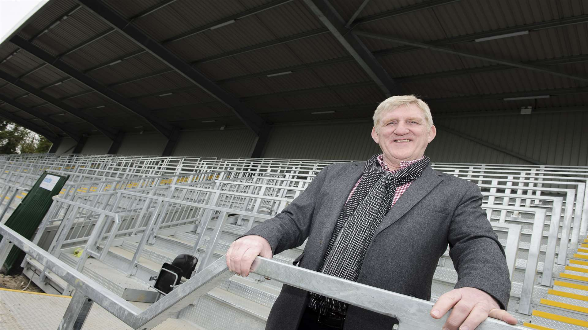 Maidstone co-owner Terry Casey in the new stand Picture: Andy Payton