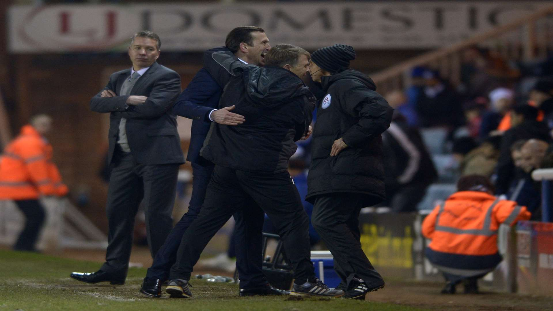Justin Edinburgh celebrates his first win, at Peterborough, with assistant Andy Hessenthaler Picture: Barry Goodwin