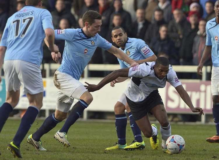 Tyrone Sterling in action for Dartford (white) against Cambridge United. Picture: Andy Payton