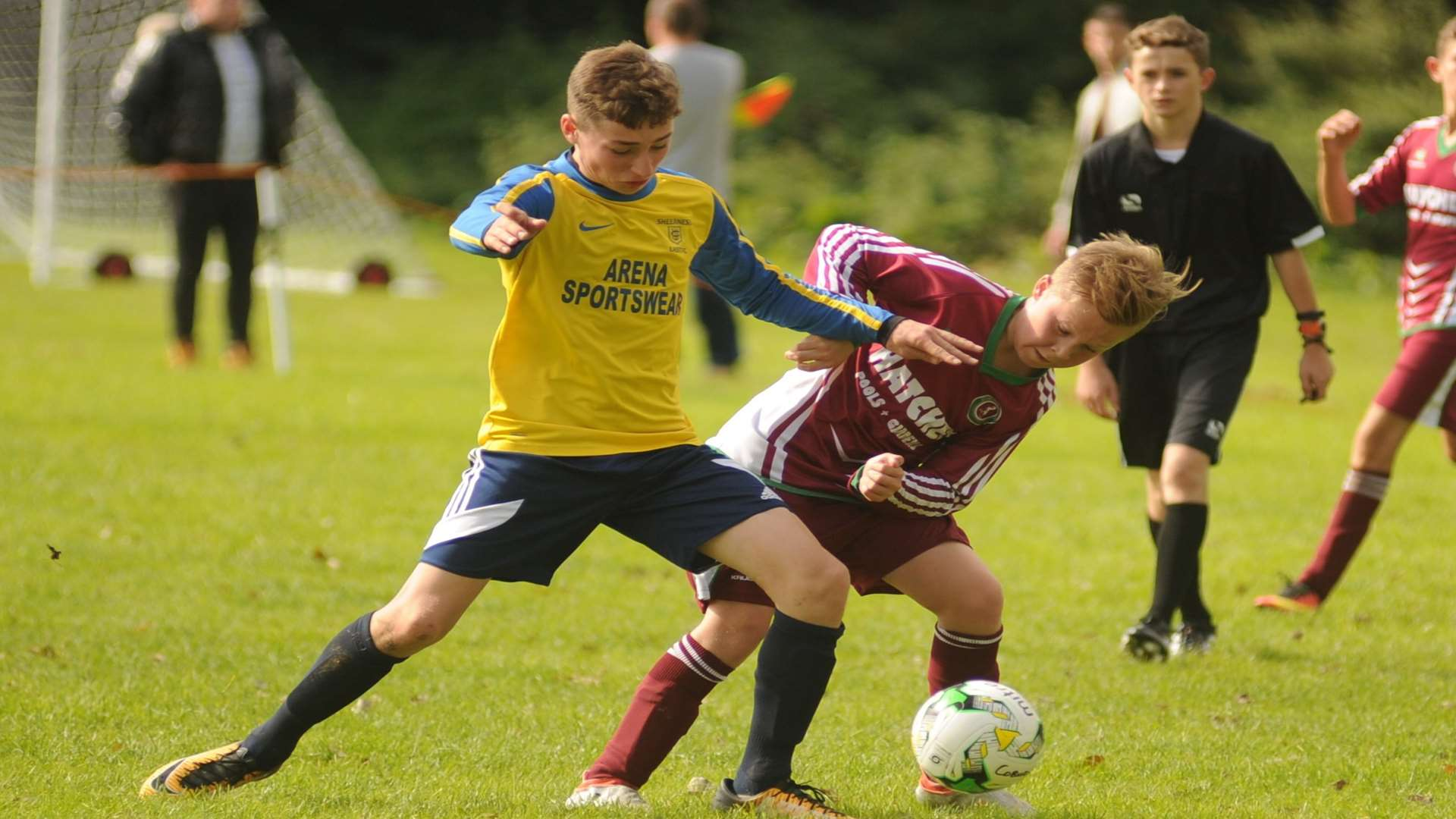 Sheerness East under-14s (yellow) take on Cobham Colts in the League Cup Picture: Steve Crispe