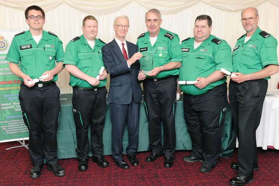 The Lord McColl of Dulwich CBE presenting Philip Le Masonry and other St John Ambulance team members with their award. Picture: Simon Hildrew and ASI.