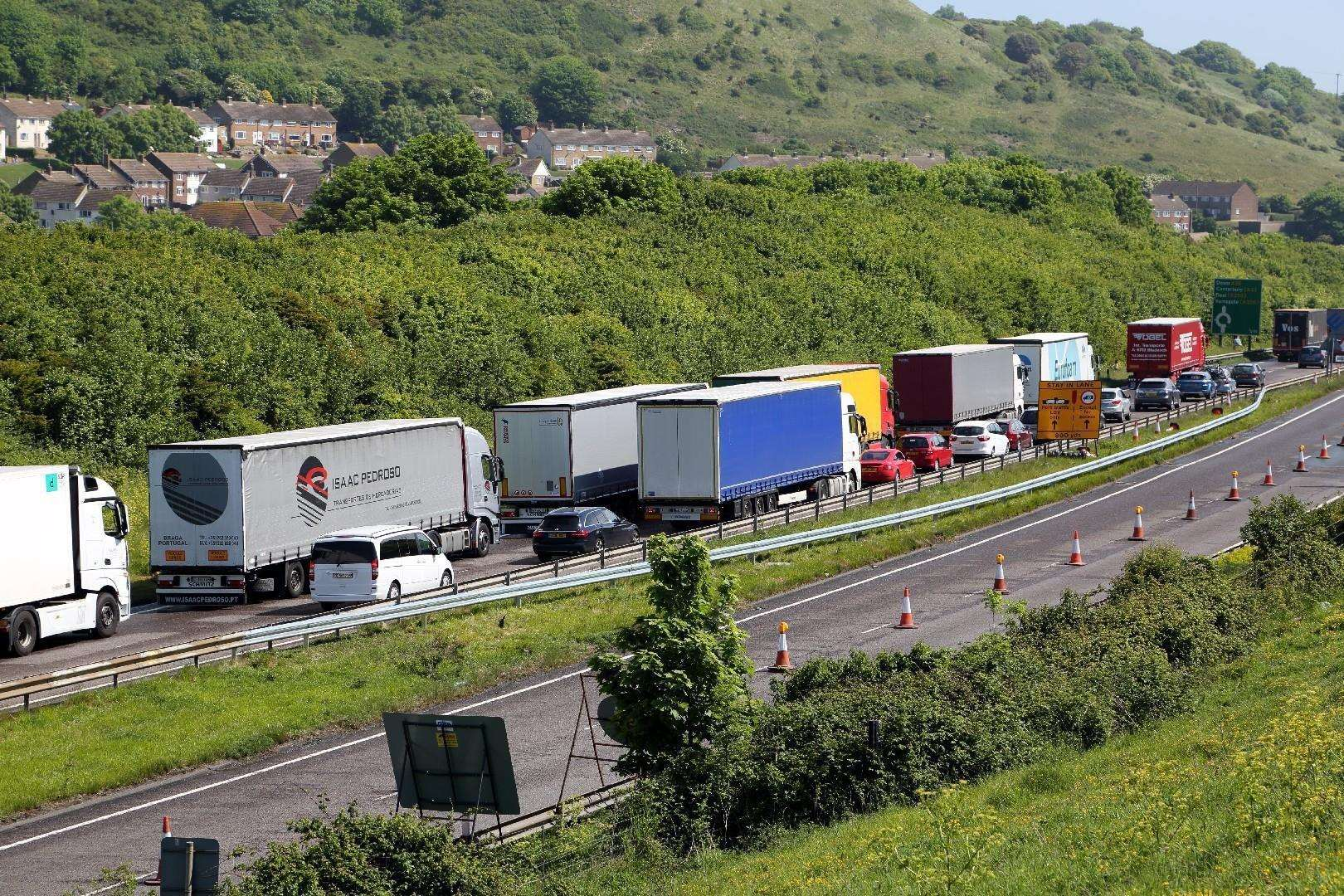 Lorries queued on the A20 heading into Dover. There are concerns Brexit may lead to increased border checks for lorries, leading to large queues