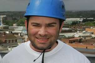 Toby Whitesman doing a charity abseil off Charter House in Ashford