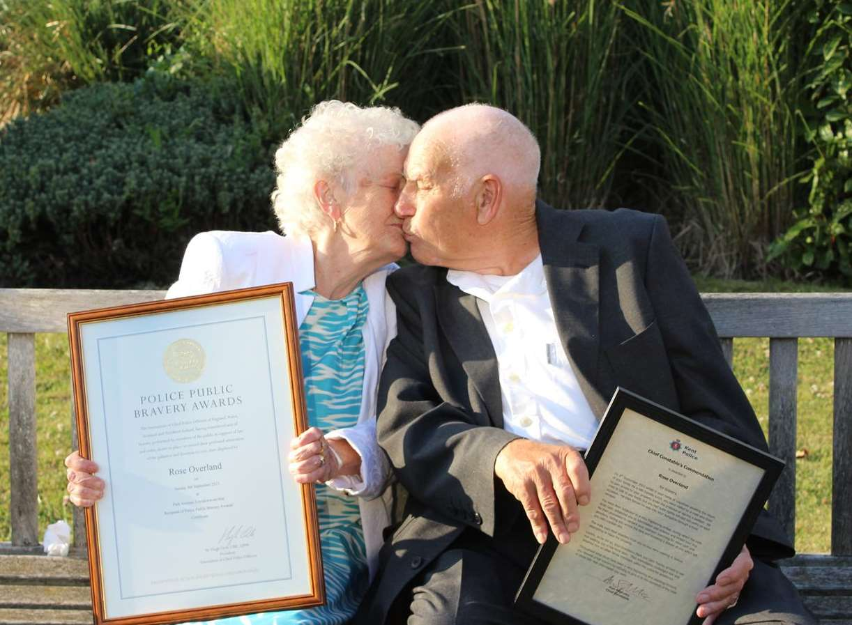 Rose Overland and her husband Derek share a kiss after the 85-year-old was presented with her award and merit for bravery