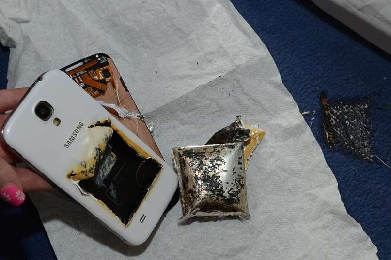 The remains of Holly Hewett's phone and scorched carpet