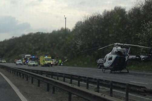 An air ambulance lands on the M25. Picture: @Kent_999s
