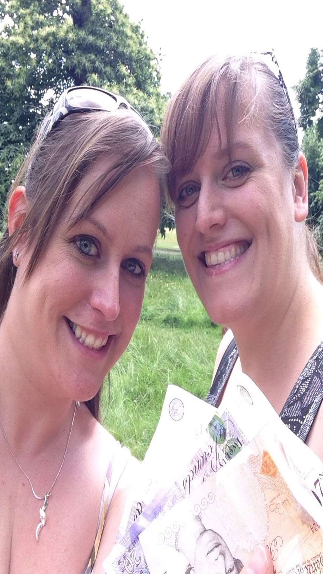 Amy and Kate Edwards tweeted this photo of themselves with the HiddenCash money