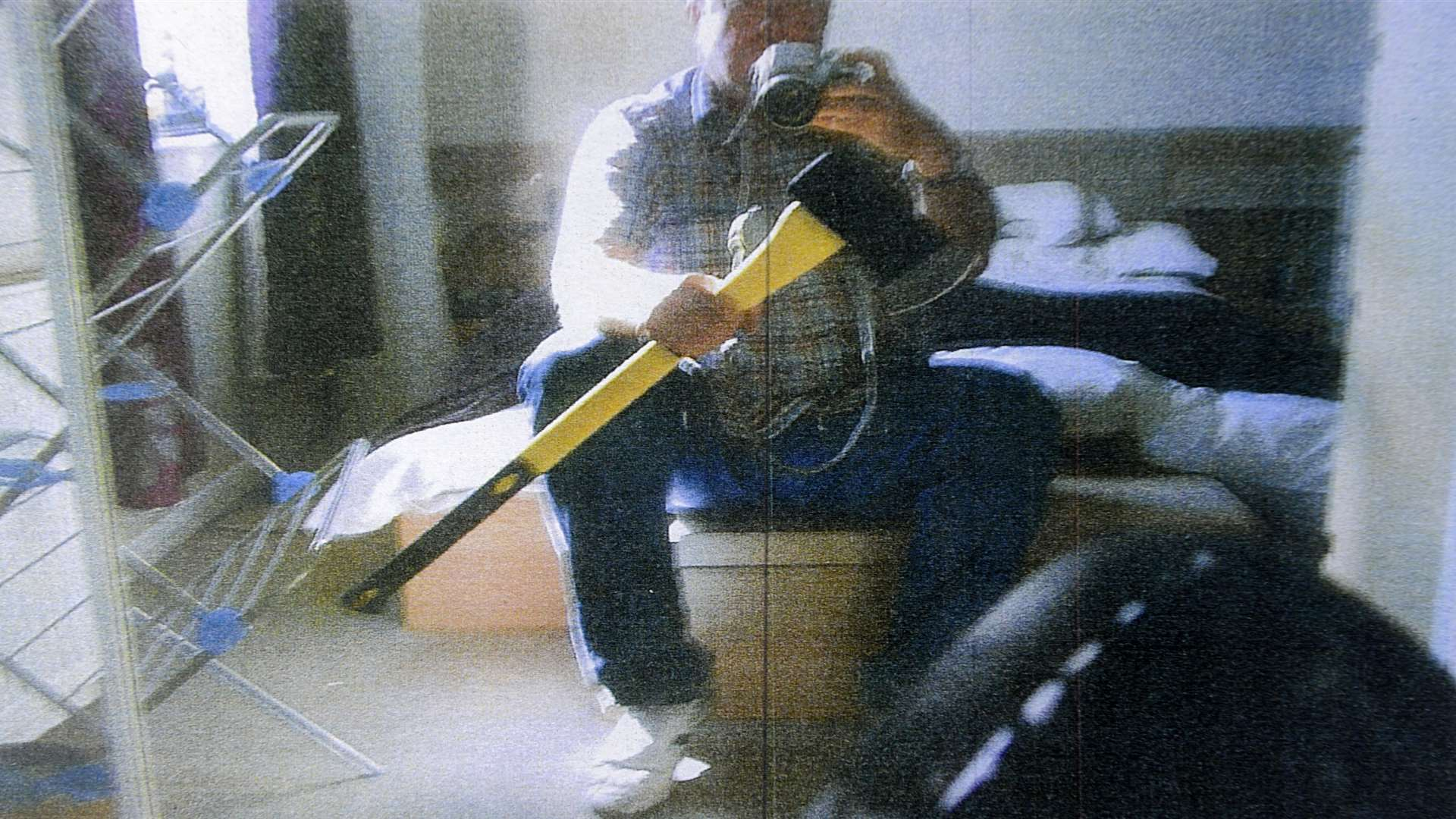 Bolinger poses with an axe - a picture which was shown to the jury during his 2014 trial