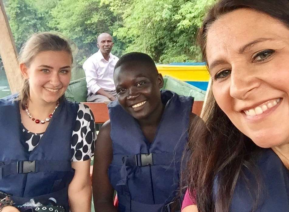 Tania Sullivan and her daughter Caitlin, 17, with Opisia Doreen in Uganda